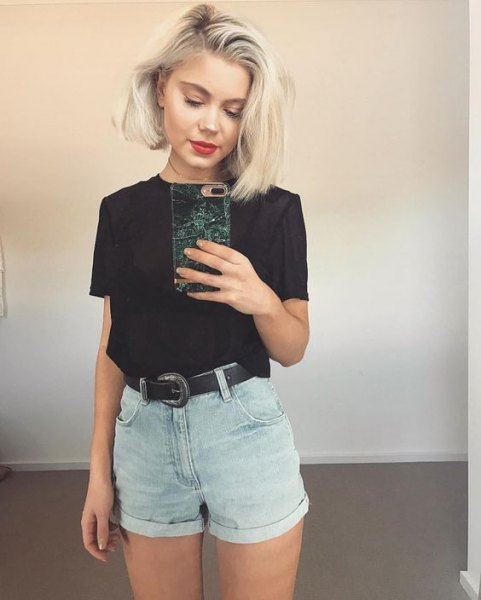 black t-shirt with gray mini denim shorts with belt