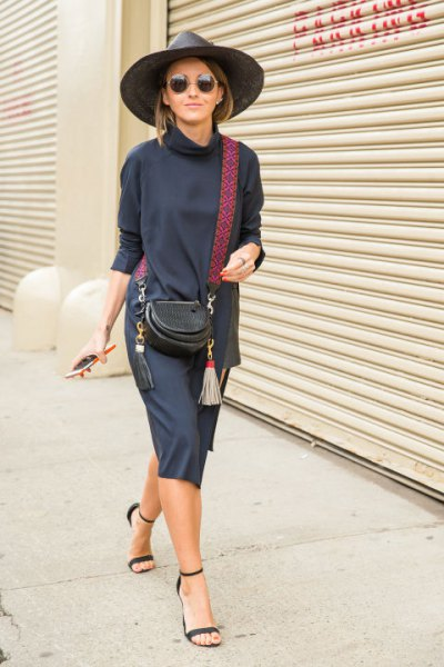 blue sweater dress with stand-up collar and dark blue sandals