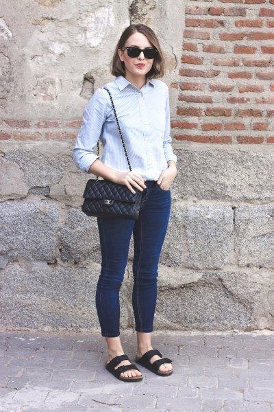 Light blue, slim cut shirt with dark skinny jeans and dark blue sandals