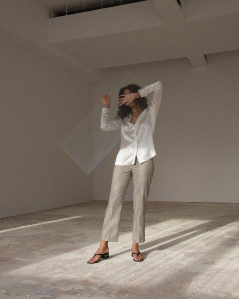 white silk shirt with gray chinos