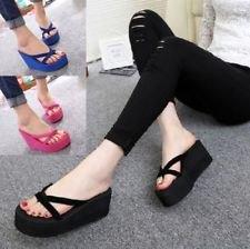 black, torn skinny jeans with flip-flop heels