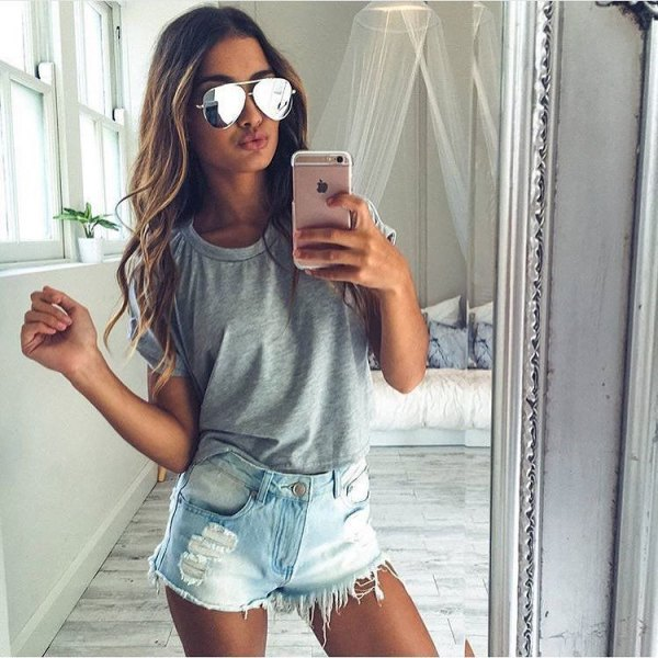 gray t-shirt with light blue denim shorts