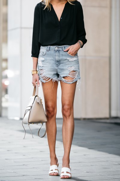 black blouse with v-neck and torn mini jeans shorts