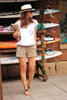 white short-sleeved wrap top with relaxed fit and green mini dress shorts