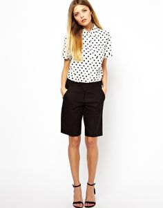white and black polka dot shirt and long shorts