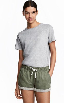 gray t-shirt with a relaxed fit and matching mini shorts made of cotton