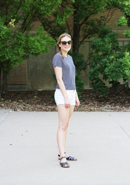 striped T-shirt with white mini cotton shorts and black slip sandals