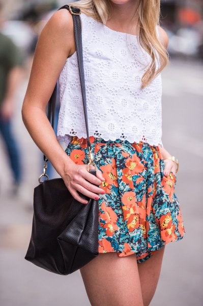 white sleeveless lace top with orange, flowing shorts