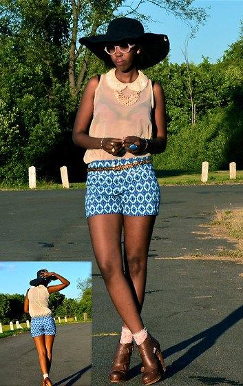 Light yellow sleeveless chiffon blouse with blue patterned shorts