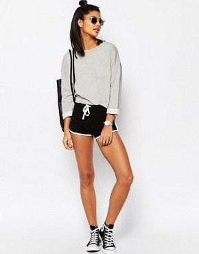 gray sweater with black mini waist shorts