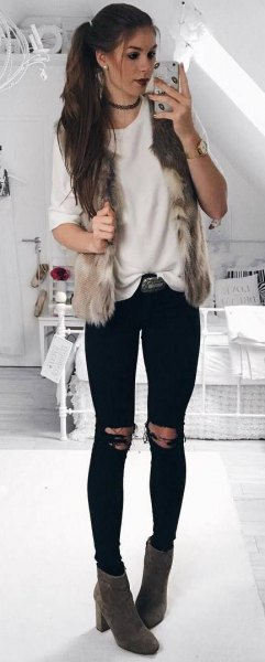 white comfortable sweater with black jeans and gray boots