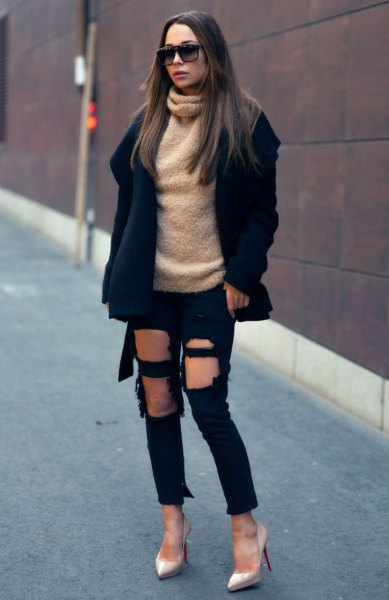 black wool coat with fluffy turtleneck and heavily torn jeans