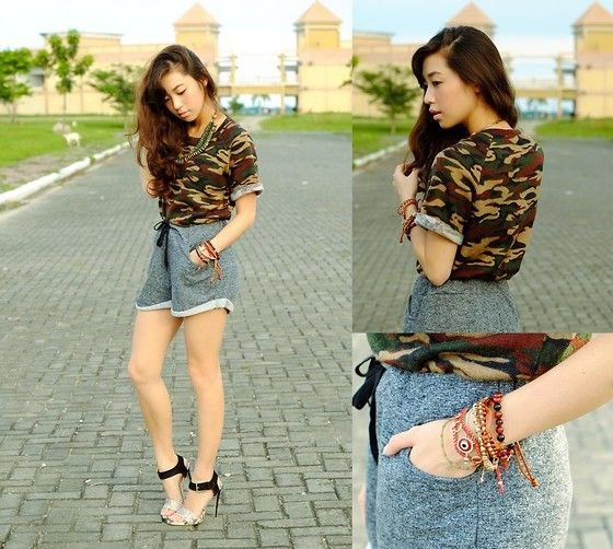 Camouflage shirt with gray shorts and high-heeled heels and sweatpants