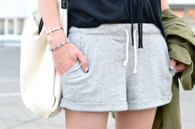 Light gray running shorts with black tank top