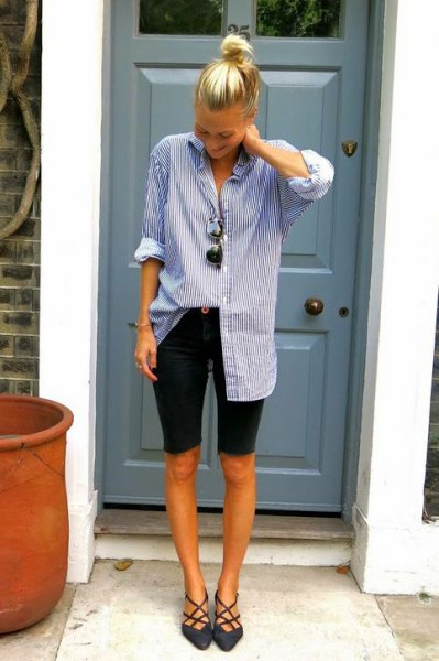 blue and white striped tunic shirt with buttons and black long shorts