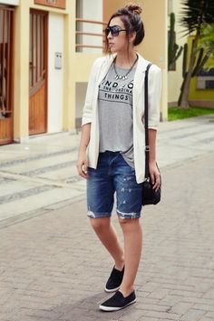 white casual blazer with gray graphic t-shirt and denim shorts