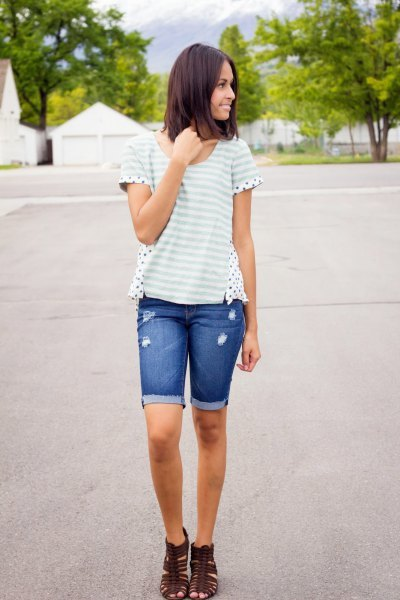 white and light gray striped t-shirt with blue denim shorts with long cuffs
