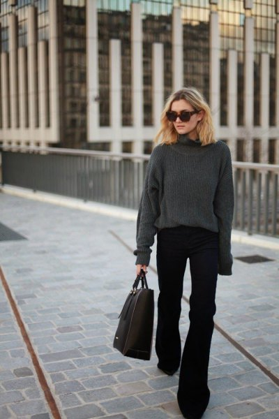 gray, thick sweater with a round neckline and black flared jeans