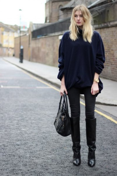 black velvet coat with matching skinny jeans and knee-high boots