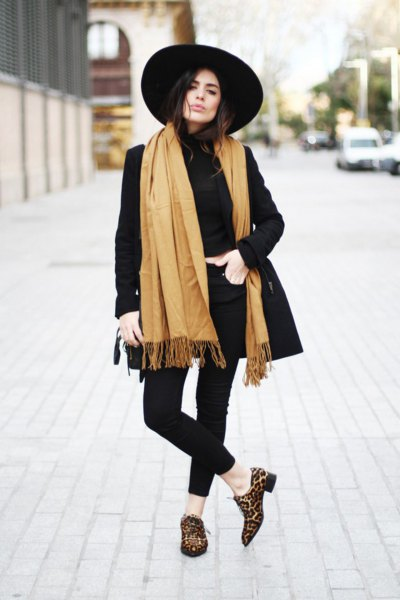 black longline blazer with orange fringed scarf and loafers with leopard print