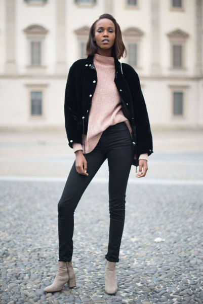 black denim jacket with ivory, chunky sweater and skinny jeans