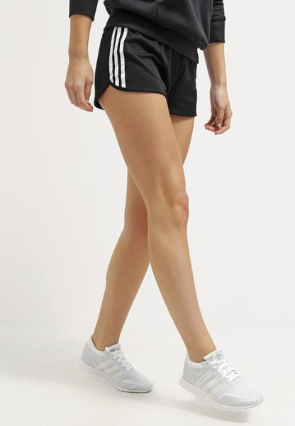 black and white striped mini running shorts with gray sweatshirt