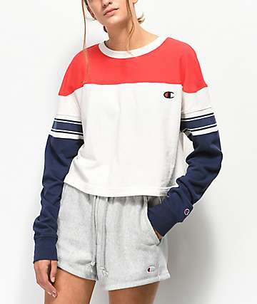 red-white and dark blue color block sweatshirt with gray shorts