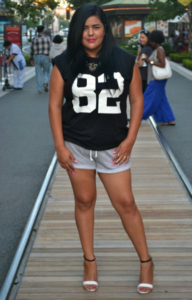 black printed sleeveless t-shirt with mini gray sweat shorts