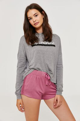 gray graphic sweatshirt with blushing pink sweat shorts with high waist