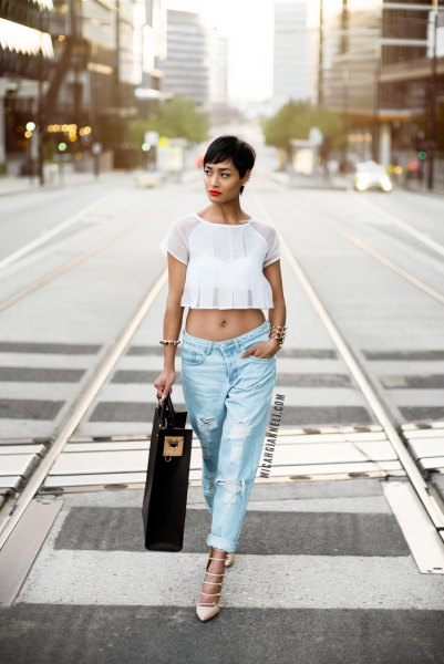 white, short-cut chiffon top with light blue, torn baggy boyfriend jeans