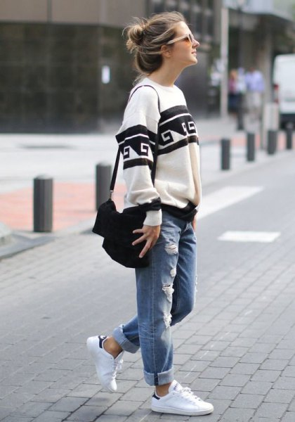 white and black tribal printed chunky sweater with cuffed jeans with cuff