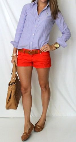 Light blue shirt with buttons and red shorts with a mini belt