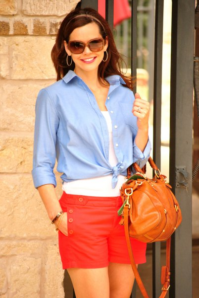 light blue knotted shirt with buttons and red shorts