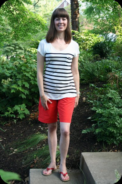 white and black striped t-shirt with scoop neck, shorts and slide sandals