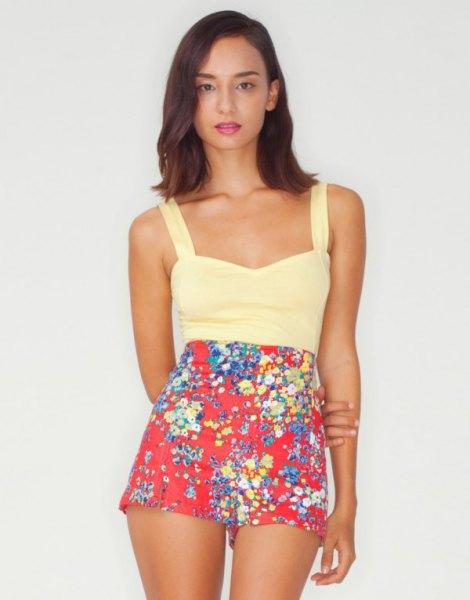 Pale yellow tank top with red floral mini shorts
