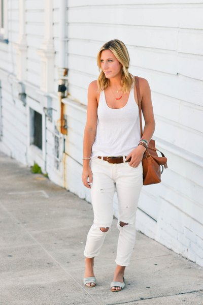 white tank top with scoop neck and torn jeans