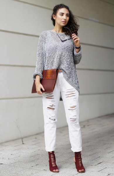 gray sweater with torn white boyfriend jeans with cuffs
