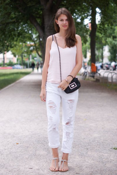 white v-neck tank with ripped boyfriend jeans and flat sandals