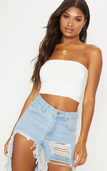 short tube top with heavily torn boyfriend jeans