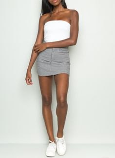 Tube top with gray, form-fitting mini skirt