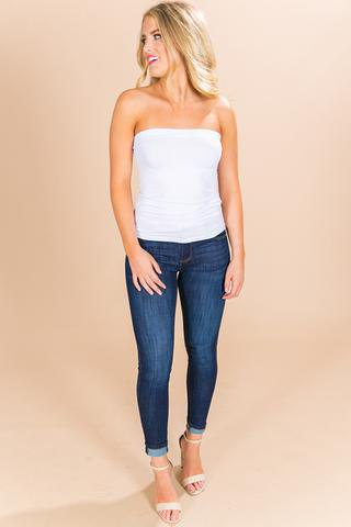 white tube top with dark blue skinny jeans with cuffs