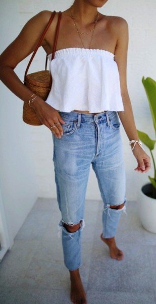 white strapless crop top with torn jeans