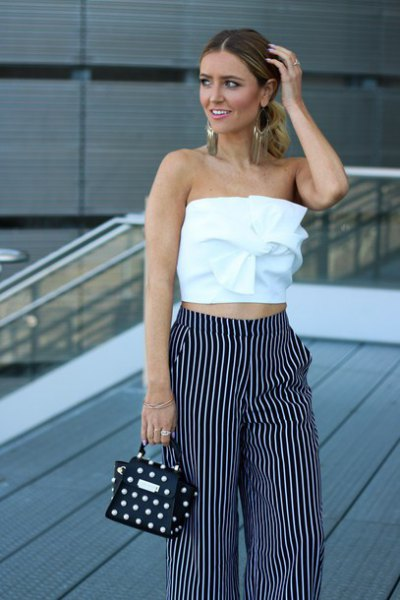 white top with front tube and striped trousers with wide legs