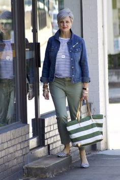 blue denim jacket with striped t-shirt and gray trousers
