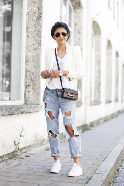 white blazer with V-neck t-shirt and heavily torn jeans