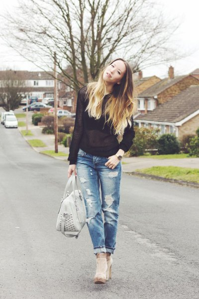 black, semi-transparent sweater with torn jeans and gray ankle boots