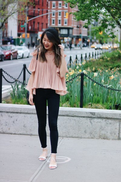 pale pink pleated chiffon blouse with cold shoulder and black jeans