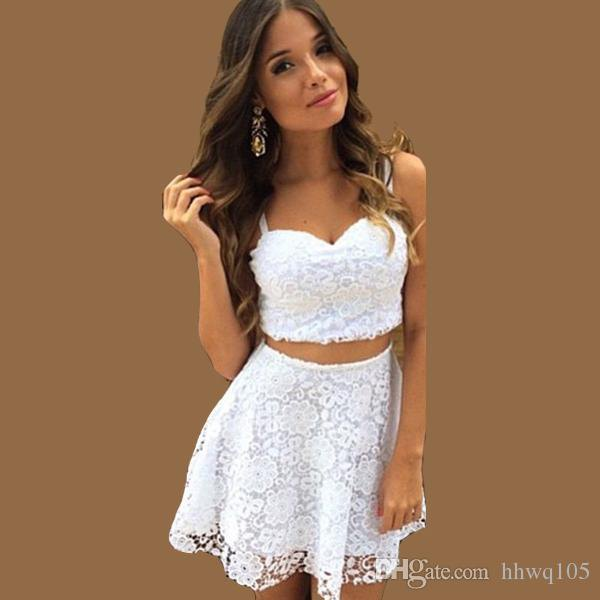 white top with a heart-shaped neckline and mini lace skirt