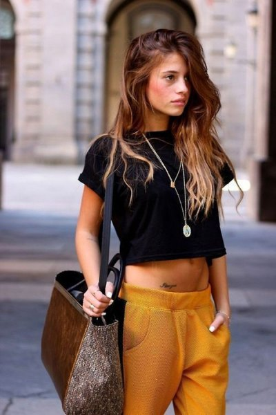black short t-shirt with green pants with a relaxed fit