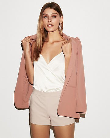 white, deep v-neck with pink shorts and red blazer